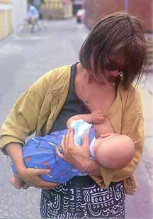 Sweedish woman breastfeeding in public